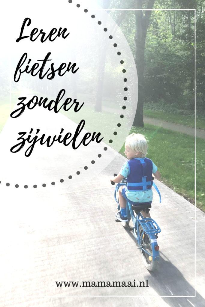 leren fietsen zonder zijwielen met handig fietsvest om mee te kunnen rennen